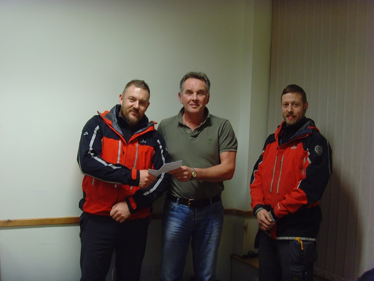 Volunteers from Dublin Wicklow Mountain Rescue receiving a donation from proceeds of the festival.